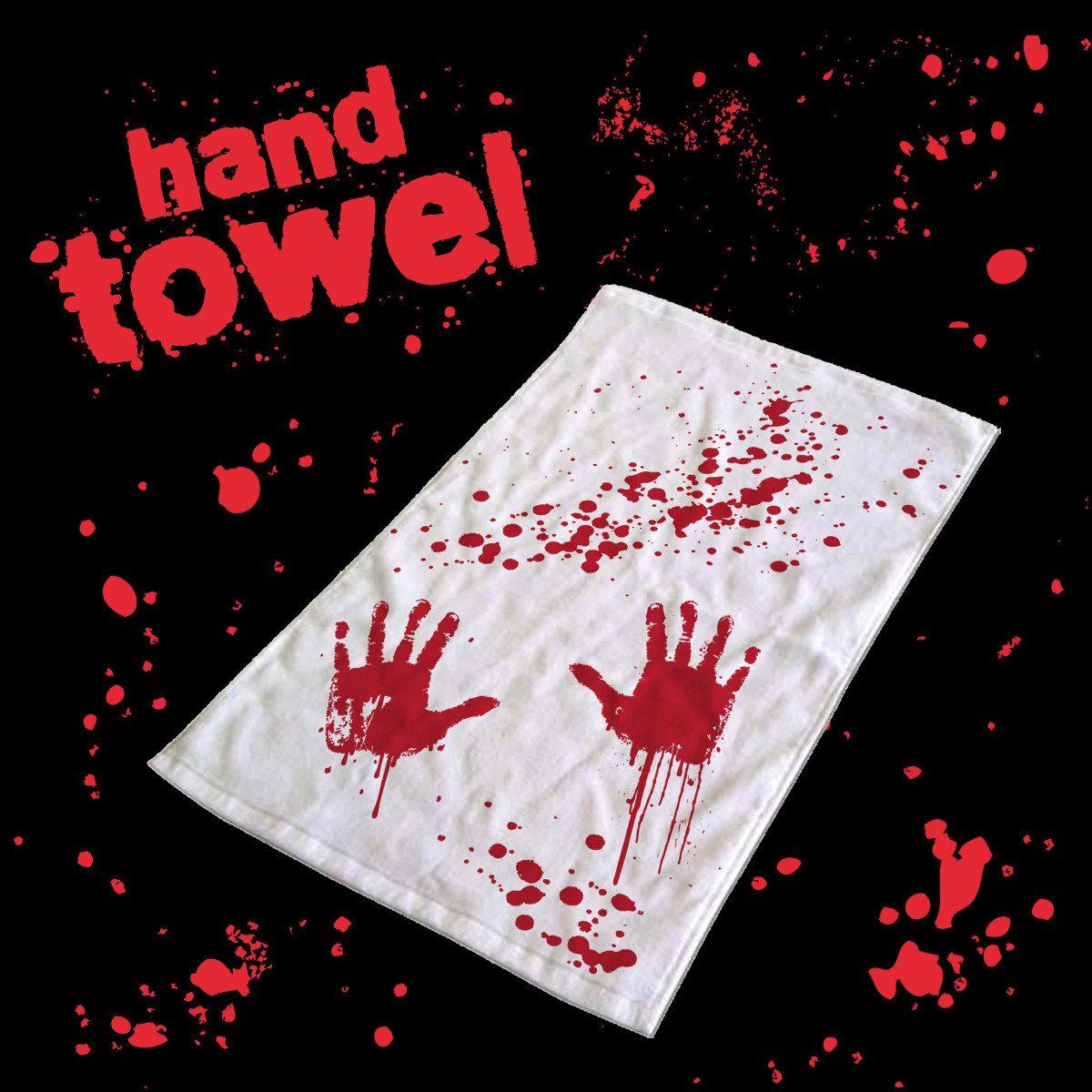 Håndklæde med blodige håndaftryk